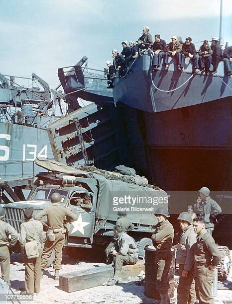 Operation Overlord Normandy A truck of the 1st Infantry Division of the United States Army is loaded into the Landing Ship Tank in Southern England...