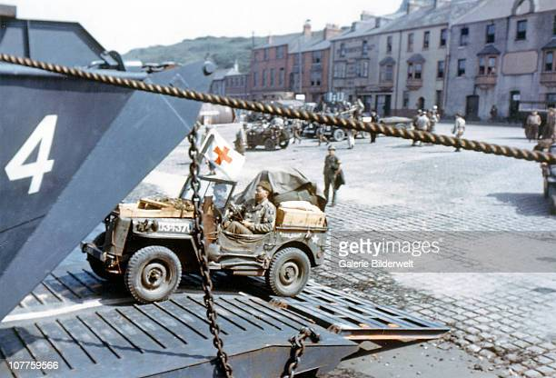Operation Overlord Normandy A United States Army ambulance jeep is entering a Landing Craft Transport in a port in Southern England June 1944 The...