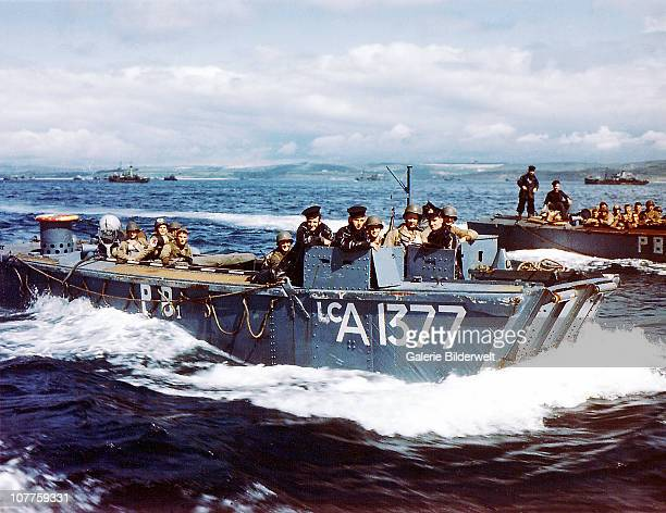 Operation Overlord Normandy British Navy Landing Crafts carry United States Army Rangers to a ship in Southern England 1st June 1944 There are...