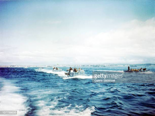 Operation Overlord Normandy, British Navy Landing Crafts carry United States Army Rangers to a ship ) in Southern England.. 1st June 1944. There are...