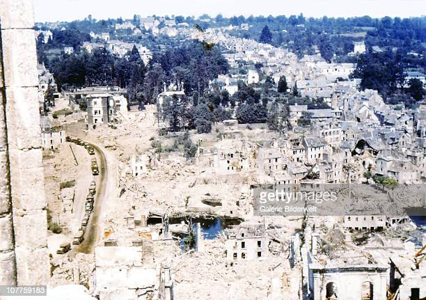 Operation Overlord Normandy Jeeps and other Unites States Army vehicles are driving through the ruins of SaintLo August 1944 The town was almost...