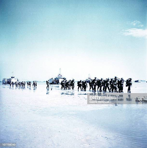 Operation Overlord Normandy, Troops of the 3rd Canadian Infantry Division are landing at Juno Beach on the outskirts of Bernieres-sur-Mer on D-Day....
