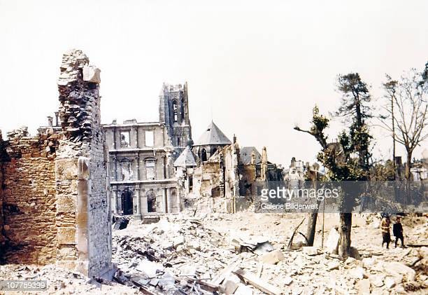 Operation Overlord Normandy Two people are walking through the ruins of SaintLo August 1944 The town was almost totally destroyed by 2000 Allied...