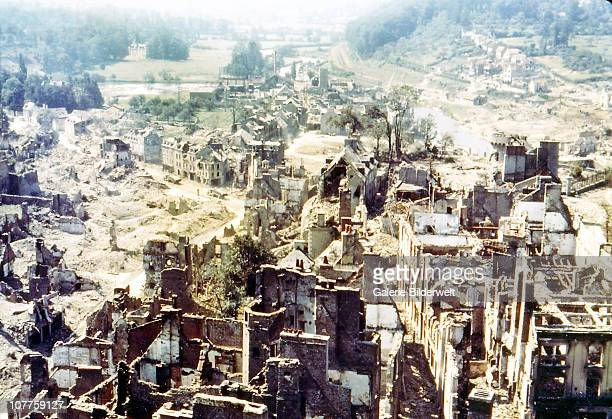 Operation Overlord Normandy Two trucks are driving through the ruins of SaintLo August 1944 The town was almost totally destroyed by 2000 Allied...