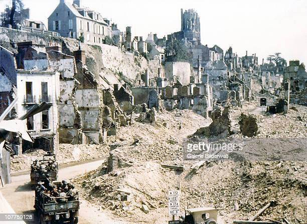Operation Overlord Normandy Two United States Army trucks and two American jeeps are driving through the ruins of SaintLo August 1944 The town was...