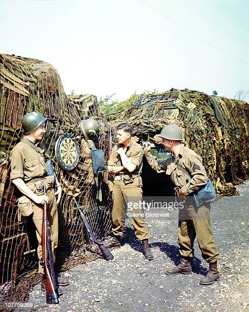Operation Overlord Three American GIs are playing dart in a camp near their port of embarkation in the south of England June 1944 The DDay invasion...