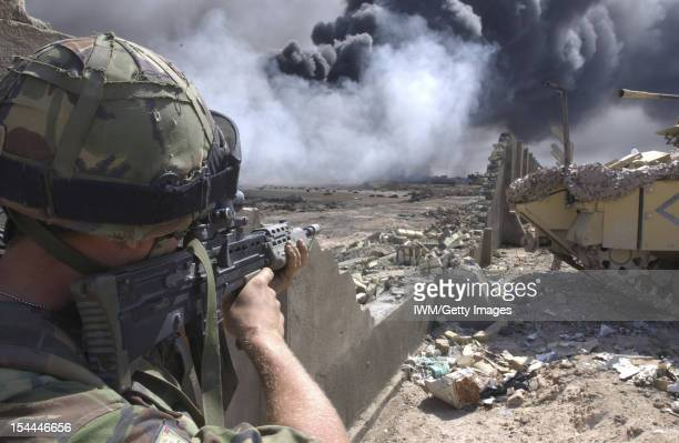British Forces In Iraq At Bridge Four on the outskirts of Basra, a soldier of 1st Battalion, The Irish Guards looks for possible Iraqi enemy...