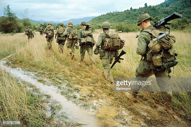 Operation Thayer IIWalking the highground that outlines rice paddies members of the 1/12th 1st Brigade 1st Cavalry go through the paces of a search...