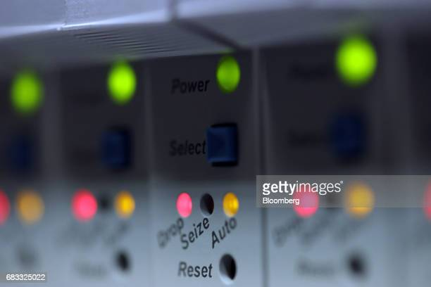 Operational indicator lights sit on the back of a computer server unit inside a communications room at an office in London UK on Monday May 15 2017...