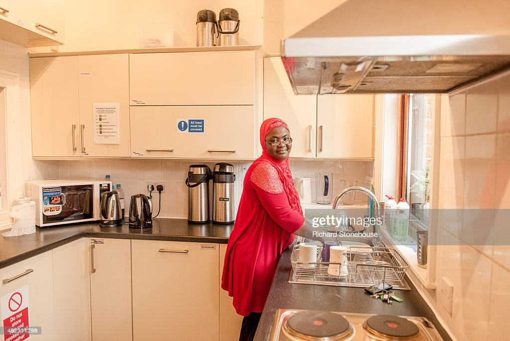 Operations Manager Bunmi Abdulrauf washes up dishes in the Communal kitchen in the Pankhurst Centre on October 8, 2015 in Manchester, England. The Pankhurst Centre was home to Emmeline Pankhurst and her daughters Christabel and Sylvia and is the birthplace of the Suffragette campaign for Votes for Women. The Parlour where the first WSPU (Women's Social and Political Union) meeting was held has been recreated as part of the museum which also hosts a number of women's organisations, projects that support women and a food bank.
