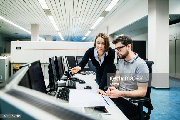 operations manager working with engineer at computer - data center stock pictures, royalty-free photos & images