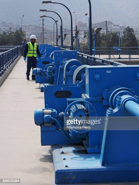 Operator inspecting the power gates of the Atarjea drinking water plant on the Rimac river The Lima Water and Sewerage Service organized a tour of...