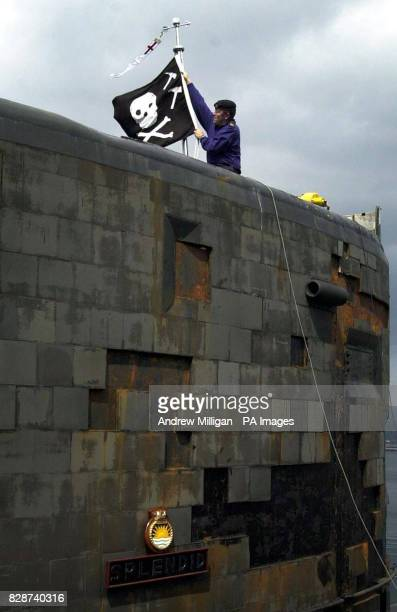Operator Mechanic Nick Mullholland takes down the Jolly Roger Flag from the soon to be decommissioned HMS Splendid as she returns from the Gulf to HM...