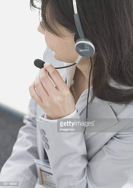 Operator wearing a headphone in the office