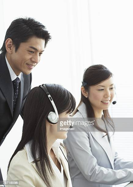 Operators and a businessman talking together