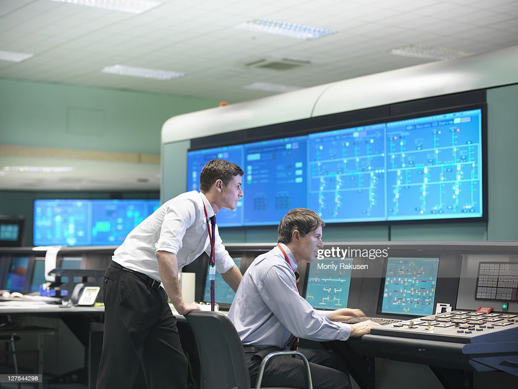Operators in power station control room : Stock Photo