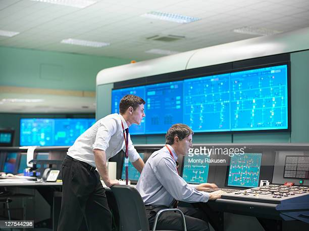 operators in power station control room - control room stock pictures, royalty-free photos & images