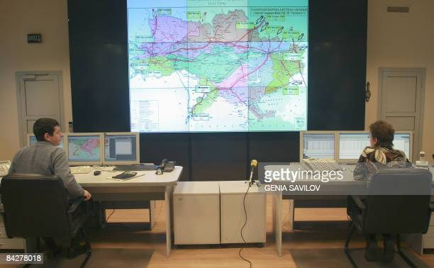 Operators look on a screen displaying gas pipelines on Ukraine's territory at a main control point of the Ukrtransgas company in Kiev on January 14...