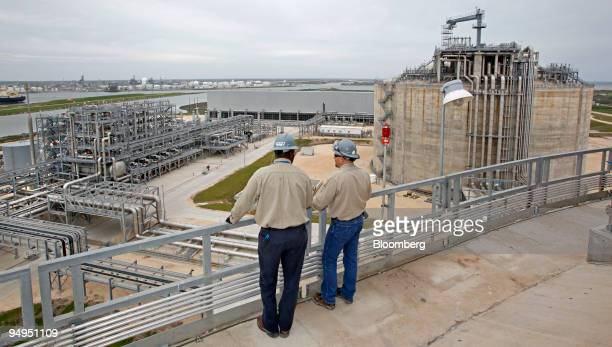 Operators Maurice Jones left and supervisor Chad Horton look down on the Freeport LNG facility in Quintana Texas US on Wednesday April 1 2009 This...