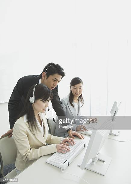Operators, talking with a businessman, working in the office
