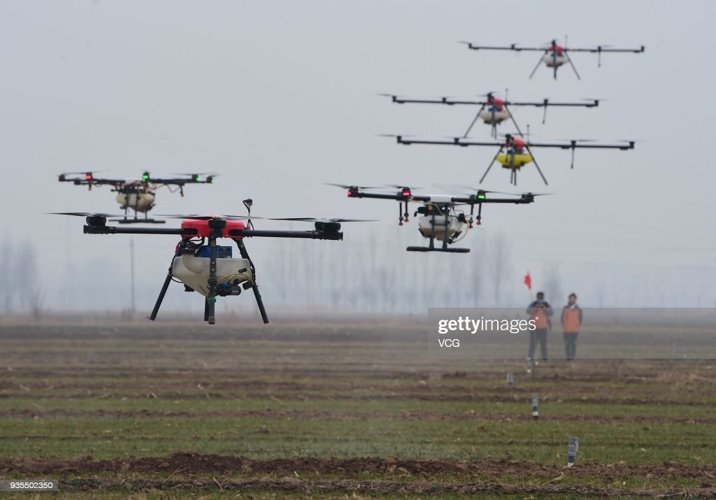 Drones Spray Pesticides On Winter Wheat In Cangzhou