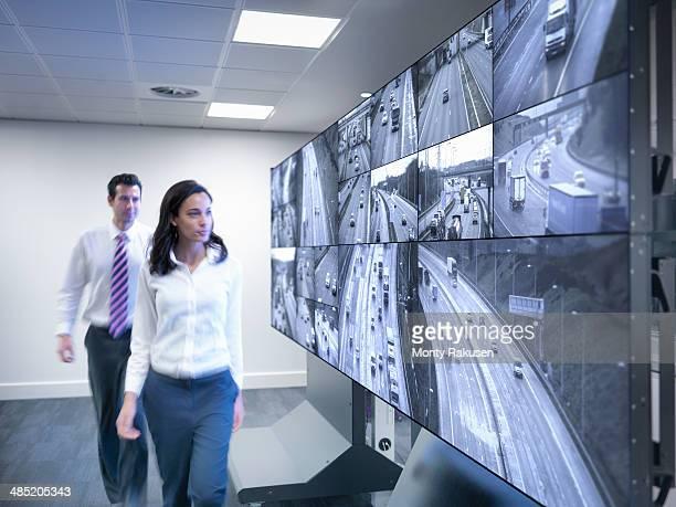Operators walking by traffic control screens