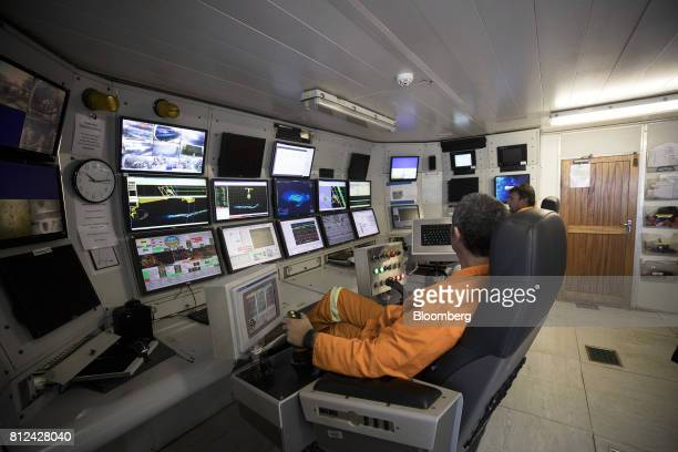 Operators watch screens showing radar scans maps and camera images in the control room as the 'crawler' machine sucks up sediment from the seabed...