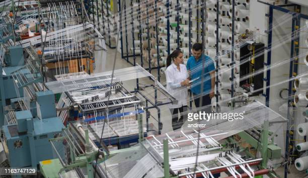 operators working at a rubber factory supervising a machine - medical procedure stock pictures, royalty-free photos & images