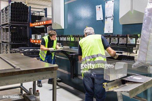 Operators working on bending machine