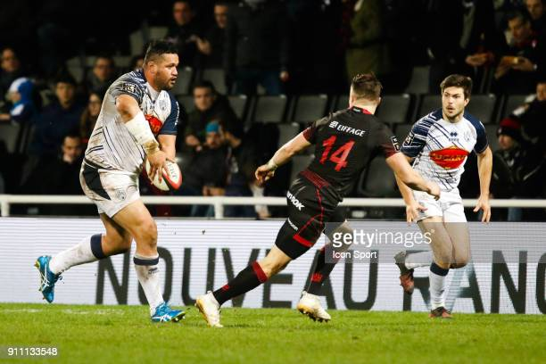 Opeti Fonua of Agen and Toby Carter Arnold of Lyon and Valentin Saurs of Agen during the Top 14 match between Lyon and Agen at Gerland Stadium on...