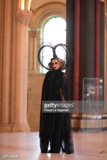 "Ophelia Kolb poses for the ""Il Medico Della Peste"" 2020/2021 Winter Franck Sorbier Haute Couture Maitre collection at the Conservatoire national des..."