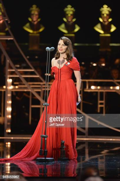 Ophelia Lovibond receives the award for Best Actress In A Supporting Role on behalf of Denise Gough on stage during The Olivier Awards with...