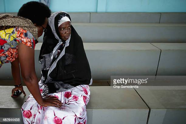 Ophelia Nyiramagumeri attends a commemoration the genocide of 1994 at the Kicukiro College of Technology football pitch April 5 2014 in Kigali Rwanda...