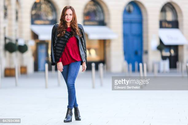 Ophelie Duvillard fashion blogger and model wears Primark black shoes Zara blue denim jeans pants a Lenny B red top and a Bodaskins black leather...