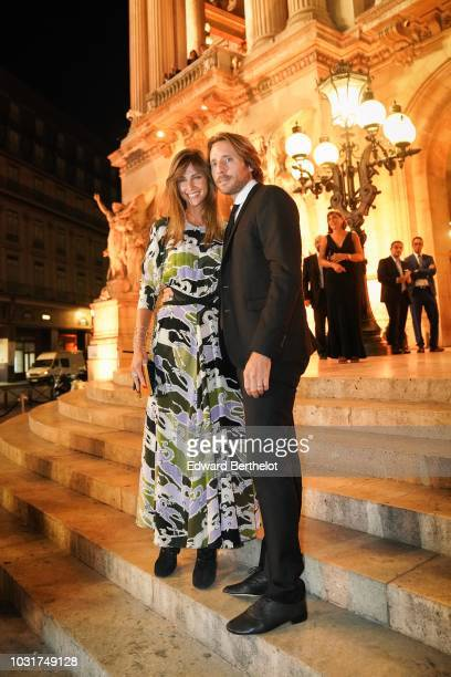 Ophelie Meunier and Mathieu Vergne are seen outside the Longchamp 70th Anniversary Celebration at Opera Garnier on September 11 2018 in Paris France