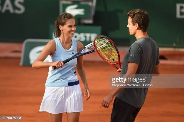 """Ophélie Meunier and Paul-Henri Mathieu attend the """"Stars, Set et Match"""" tournament at Roland Garros on October 07, 2020 in Paris, France."""