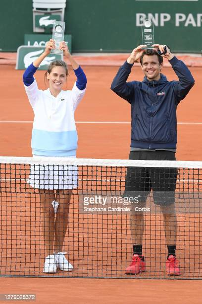 """Ophélie Meunier and Paul-Henri Mathieu winners of the """"Stars, Set et Match"""" tournament at Roland Garros on October 07, 2020 in Paris, France."""