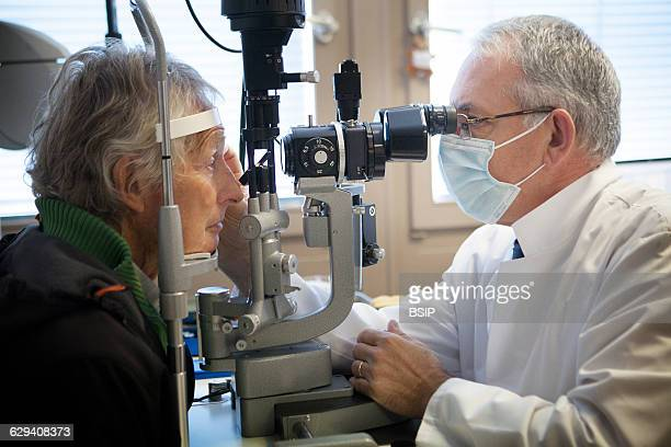 Ophtalmological practice Geneva Switzerland The ophtalmologist examines a patient with a slit lamp