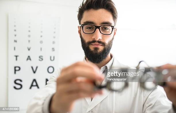 Ophthalmologist doctor looking a phoropter glasses