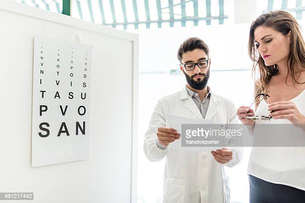 Ophthalmologist doctor talking with the patient