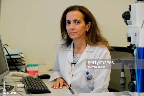 """Ophthalmologist Nada Jabbour, a member of a group of Lebanese doctors who have dubbed themselves """"The White Coats"""", poses for a picture at her clinic..."""