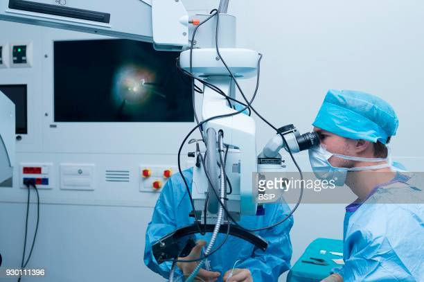 Ophthalmology surgery Pasteur 2 Hospital Nice France treatment of a retinal detachment through vitrectomy The doctor is helped by an intern