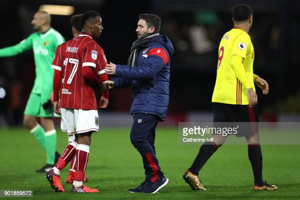 Opi Edwards of Bristol City shakes hands with Lee Johnson manager of Bristol City after The Emirates FA Cup Third Round match between Watford and...