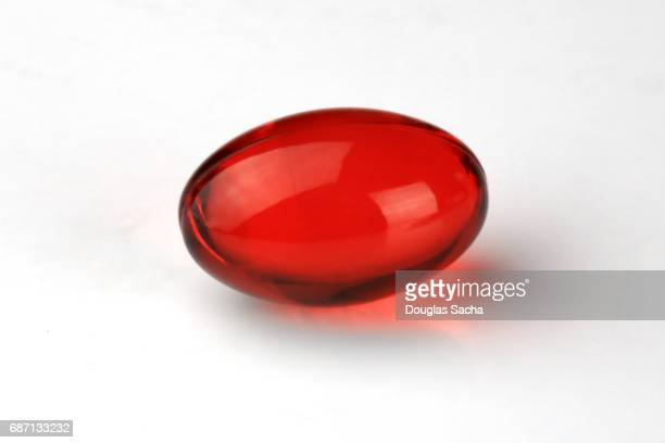 Opiate pain reliever pill on a white background