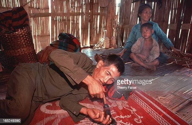 Opium addict in a northern Wa State village