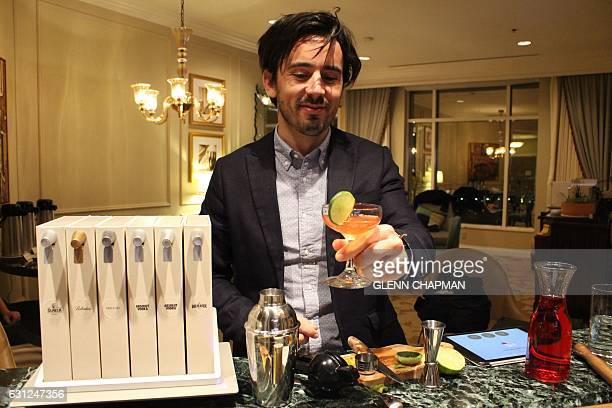 Opn manager Tristan Capelier serves up a cosmo created using a Pernot Ricardbacked home mixology unit being readied for market at the Consumer...