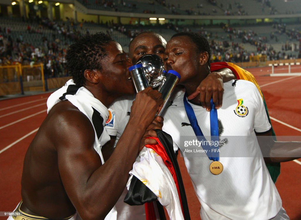 Opoku Agyemang, Daniel Opare and Samuel Inkoom of Ghana celebrate with the FIFA U20 World Cup after victory over Brazil in the FIFA U20 World Cup Final between Ghana and Brazil at the Cairo International Stadium on October 16, 2009 in Cairo, Egypt.