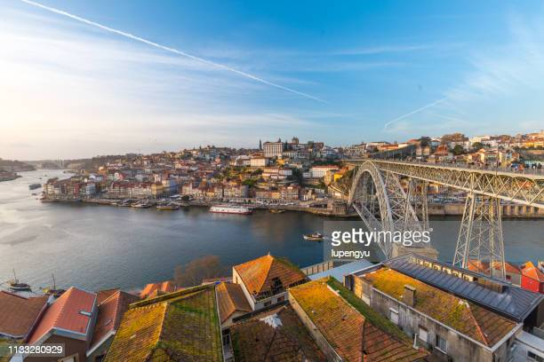 oporto city with douro river and dom luiz bridge under blue sky, portugal. - porto portugal stock pictures, royalty-free photos & images