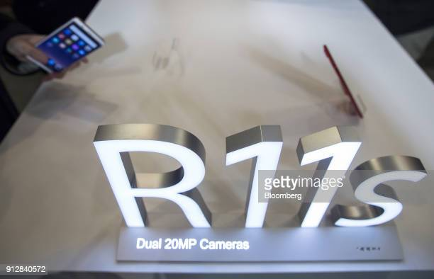 Oppo R11s smartphones are displayed during a launch event of the smartphone for the Japanese market in Tokyo Japan on Wednesday Jan 31 2018 Oppo...