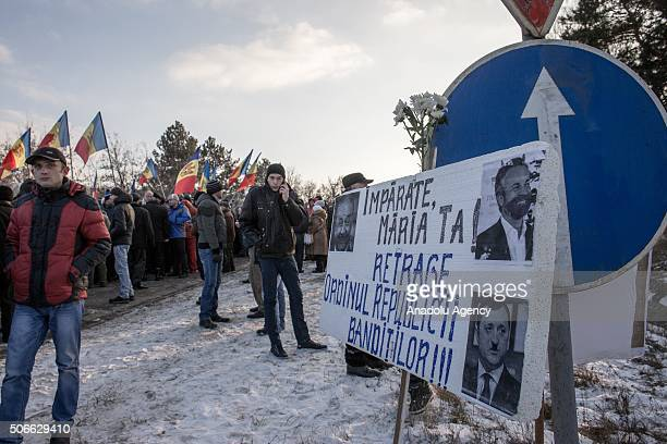 Opponent Moldavians shout slogans and carry Moldavian flags as they march during an antigovernment protest demanding resignation of the government...